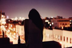 silhouettes talking on the roof with bright backdrop of city nightlife - Scene 11