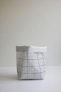 Sack. Geometric pattern printed on PVC-laminated white polyester scrim