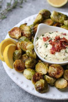 Roasted Brussels Sprouts with Bacon Aioli | healthy brussels sprouts recipes | homemade brussels sprouts | how to cook brussels sprouts | healthy side dishes | healthy appetizer recipes | whole30 appetizer recipes | gluten-free appetizers | dairy-free appetizers | paleo appetizers || The Real Food Dietitians #whole30appetizers