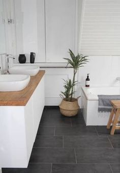 our new DIY bathroom. Renovation on a budget is finished!) i like the combination of cold elements like white walls and grey floor with warm elements like wood and plants I Badezimmer selbst renovieren. So sieht unser Badezimmer jetzt aus, graue Fliesen, Grey Bathroom Floor, Wood Bathroom, Laundry In Bathroom, Bathroom Flooring, Kitchen Flooring, Bathroom Interior, Gray Floor, Bathroom Ideas, Master Bathrooms