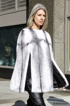 When the temperature drops, layer a fur cape over a comfy sweater. You'll look stylish while also keeping warm. Let DailyDressMe help you find the perfect outfit for whatever the weather!