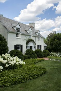 Garden Design Ideas : green and white landscaping + painted white brick house. classic and lovely! Painted White Brick House, White Brick Houses, Landscape Architecture, Landscape Design, Garden Design, Landscape Plans, Le Ranch, Front Yard Design, Traditional Exterior