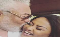 Ex-president Rawlings and Nana Ama McBrown hugging and kissing each other.