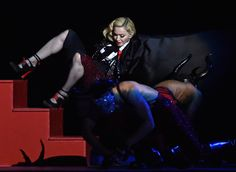 Madonna took a tumble during her performance at the Brit music awards at the O2 Arena in London