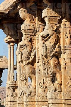 Pillars at the Vittala Temple depicting riders on the Yali, a mythical beast with head of a lion, tusks of an elephant and tail of a serpent.