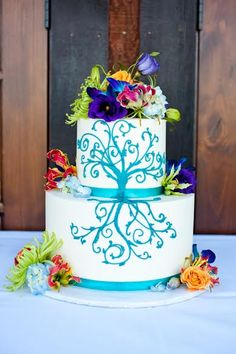 A gorgeous cake with beautiful bright flowers to match the the Brides beautiful bouquet.