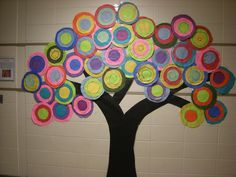Large tree with the kids' Kandinsky-inspired circles (fr: WHAT'S HAPPENING IN THE ART ROOM??: Kandinsky Trees-1st Grade)