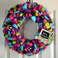 I like the idea of a ribbon wreath with a chalk board to write my name for my classroom door.