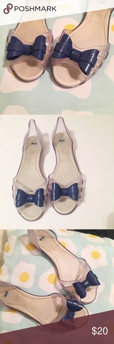 MEL Melissa jelly bow sandals Women's Sz 9 Adorable (& comfy!) women's Melissa jelly sandals with blue bow! Totally unique, conversation starter for sure! I love them because they are comfy too :) Jelly sandals, size 9. Some wear on the foot beds, can't see while you are wearing them. Light blue with dark blue bows. See pictures! Melissa Shoes Sandals
