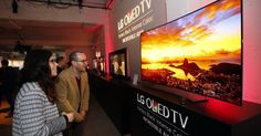 LG's OLED TVs are jaw-droppingly gorgeous, but the price still isn't anywhere near the level it needs to be for mass consumer adoption. Hopefully the company's new manufacturing plant can help that. Art Display Panels, Lg Display, Oled 4k Tv, Lg Oled, Dallas Safari Club, Nanoleaf Aurora, Economies Of Scale, Art And Craft Shows, Lg Tvs