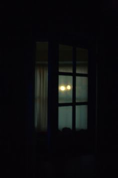Headlights in the window. Write about it.