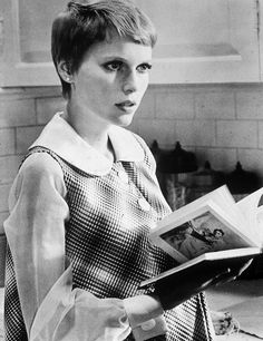 Mia Farrow reading in Rosemary's Baby, 1968.