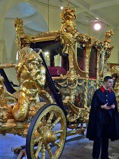 Royal Footman explains the history of Britains Coronation Coach at the Royal Mews in London