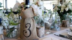 Fab mix of rustic items in the centrepieces using hessian sacks, love the various little floral clusters and candle holders