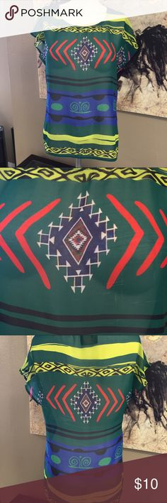 Beautiful sheer top Aztec print dark green top. Green, blue, yellow. 19 in pit to pit. No stretch coveted Tops Blouses