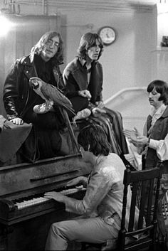 """Goldblatt: """"They had recently recorded """"Hey Jude"""" and so Paul is playing """"Hey Jude,"""" and they're all singing, and the parrot is just a prop that Paul's girlfriend brought along. She was the prop girl. It was taken in the Mercury Theatre in Notting Hill."""" Rare Beatles photos at the gallery of the UC Berkeley Graduate School of Business. Photo: Stepen Goldblatt"""