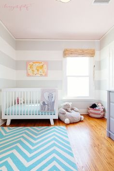 We love this bright, modern take on an elephant safari-themed nursery!