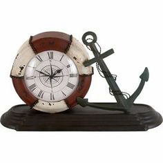 "Distressed metal table clock with a nautical motif.   Product: ClockConstruction Material: MetalColor: Brown, red, and ivoryAccommodates: Batteries - not includedDimensions: 8"" H x 14"" W x 5"" D"