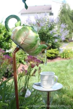 s 17 reasons to drop everything and buy cheap thrift store dishes, crafts, repurposing upcycling, Make adorable garden decor from a tea set