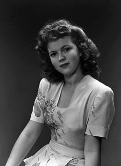 A very grown up Shirley Temple.