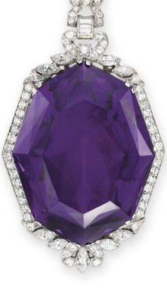 [DETAIL] AN AMETHYST AND DIAMOND PENDANT NECKLACE Suspending an octagonal-cut amtheyst, weighing approximately 112.60 carats, within a circular and marquise-cut diamond surround, from an openwork circular, marquise and baguette-cut diamond geometric link, to the collet-set and marquise-cut diamond neckchain, mounted in platinum.