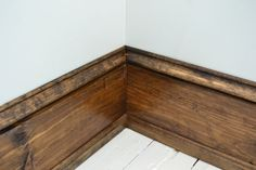Family room- thick baseboards 1 x 6 pine for the meat of the baseboard, base cap on the top of the wide pine, and colonial stop to cover the gap between the baseboard and the floor. Wood Baseboard, Baseboard Styles, Baseboard Ideas, Dark Baseboards, Home Improvement Projects, Home Projects, Pine Trim, Farmhouse Trim, Farmhouse Ideas