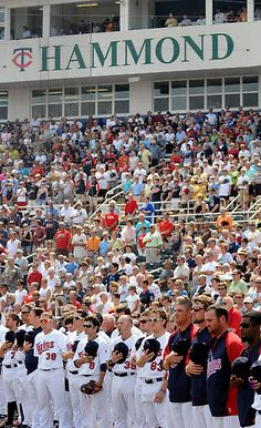 Minnesota Twins and their fans stood for the singing of the National Anthem before play started at Hammond Stadium in Fort Myers, Florida, Saturday, March 3, 2012. (Pioneer Press: Chris Polydoroff)