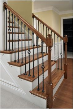 Best Hickory Suede Hardwood With Matching Newel Post White Spindles And Carpeted Treads 400 x 300