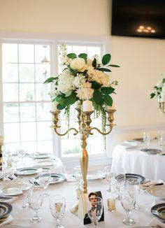 One style of table arrangements using a candelabra #thompsonhouseandgardens #flowersbyon