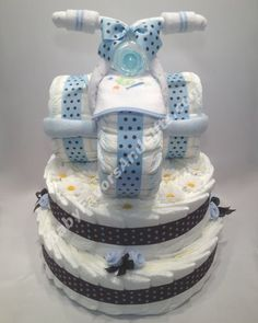 Tricycle diaper cake, unique baby shower gift ideas for baby boy.I'll do which one Kala likes best! Baby Shower Gifts For Boys, Unique Baby Shower Gifts, Boy Baby Shower Themes, Baby Shower Fun, Baby Gifts, Regalo Baby Shower, Mesas Para Baby Shower, Baby Shower Diapers, Baby Shower Cakes