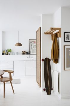 White kitchen with wood details - via cocolapinedesign.com