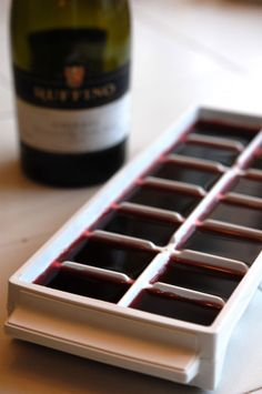 Once the cubes freeze, just pop them out and stick them in a baggie.  Wine does freeze, contrary to popular belief.  It just doesn't freeze as hard as water would.  When you come across a recipe that calls for wine, just grab a few cubes and you're set.