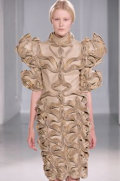 Wearable Art - dress with intricate wave patterns and sculptural silhouette - innovative fabric manipulation; 3D fashion // Iris van Herpen