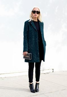All black outfit with colored printed coat.