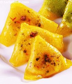 Thin petha slices stuffed with pistachio sandesh.