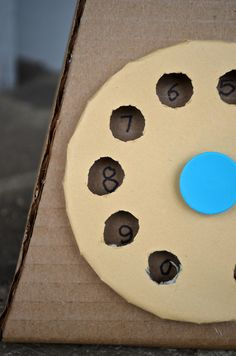 Cardboard Upcycle- some sort of game that involves spinning and dial and adding or subtracting?