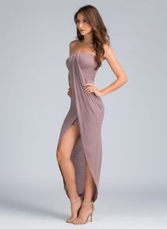Put on this dress and appreciate the art of drapery. The draped front is the perfect finishing touch to this tube dress.