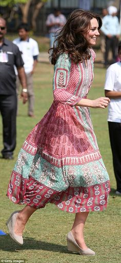 Kate looked radiant as she jogged around in her towering wedges and flowery summer dress having dressed down from her earlier outfit