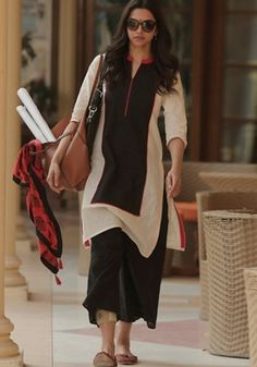 Shop online bollywood actress Deepika Padukone black and off white palazzo salwar kameez. This Deepika Padukone style palazzo salwar kameez is prettified with exclusive lace. Kurta Designs, Dress Designs, Indian Attire, Indian Wear, Indian Dresses, Indian Outfits, Western Outfits, Fashion Tips For Women, Womens Fashion