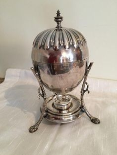 Mystery Item   Collectors Weekly Egg coddler #sterling #silver #warmer #eccentric #tableware  #antique #sever #eggs #coddled