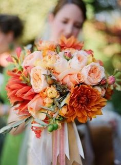 Summer peach wedding bouquet with dahlias and garden roses. Obsessed. May need to sub in something gray for the green. but love the textures together!