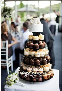 Petite tower wedding cake- giving your guests options. A clever idea:)