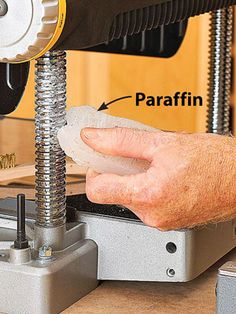 Clean the head elevation screws and guide posts by blowing away dust and chips with compressed air. Use a brass-bristle brush if needed. Then lubricate the posts and threads with dry paraffin wax for smoother movement.