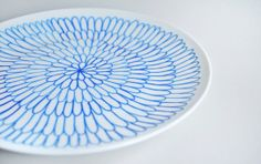 Hand Decorated White curved plate in geometric by perchdecor, $20.00
