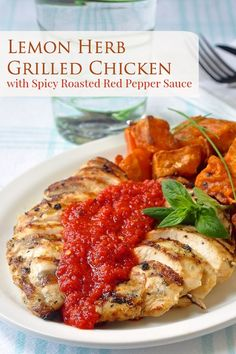 Lemon Herb Grilled Chicken with Spicy Roasted Red Pepper Sauce - simply marinated lemon and herb grilled chicken breasts served with an easy to prepare roasted red pepper sauce.
