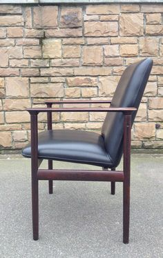 Anonymous; Rosewood and Leather Armchair by  Fristho, 1960s.