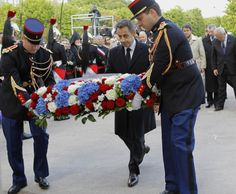 France's President Nicolas Sarkozy (C) lays a wreath in front of the Armenian Monument as he attends a ceremony in Paris to mark the mass killing of Armenians by Ottoman Turks 97 years ago April 24, 2012.