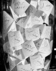 """At Darcy Miller's wedding, fortune tellers added a special touch. On the bars, large glass containers held paper cootie catchers; inside were """"dares"""" -- such as """"kiss the bride"""" and """"introduce yourself to someone new"""" -- to prompt guests to mingle."""