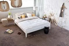 White bed with brown carpet of Desso