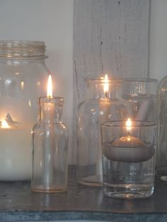 Grouping candles in diferent glass jars and vases.   source d'Angèle